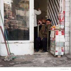 Cigarette seller napping, Enqelaab Street, Tehran